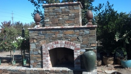 A picture of an outdoor stacked stone fireplace that was built in Carmichael, CA